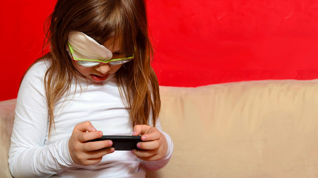 partially blined girl using smartphone